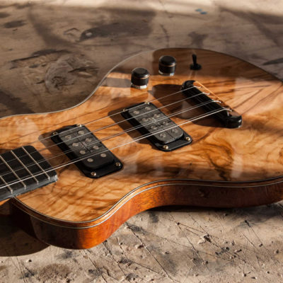 8 String Electric Tenor. Mahogany solidbody with Olive top, Mahogany neck and bindings. Custom handmade pickups by Mama Pickups.