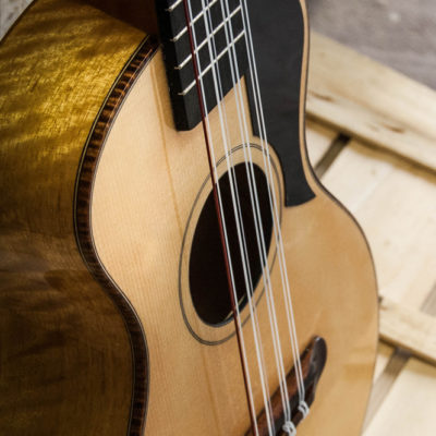8 String Tenor with Spruce soundboard and Movingui back and sides. Ebony fingerboard and Mahogany neck and dyed Maple bindings.